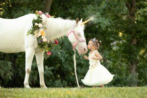 unicorn kisses little girl